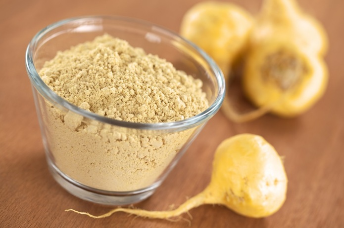 Maca-powder-flour-in-glass-bowl-with-maca-roots-or-Peruvian-ginseng-lat.-Lepidium-meyenii
